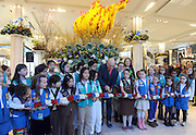 Mike Gansmoe, center, executive producer of the Macy's Flower Show, joins Girl Scouts of the USA to cut the ribbon to officially kick off the 42nd Annual Macy's Flower Show, America the Beautiful, Sunday, March 20, 2016, at Macy's Herald Square in New York. (Diane Bondareff/AP Images for Macy's Inc.)