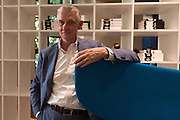 Giulio Cappellini, art director of the Italian design firm Cappellini, poses at Cappellini Point showroom in Milan, May 25, 2016. Cappellini presents his new book Metodo Cappellini, Mondadorri Electa publisher. &copy; Carlo Cerchioli<br /> <br /> Giulio Cappellini, architetto e direttore del marchio di design Cappellini, posa nello showroom Cappellini Point a Milano, 25 maggio 2016. Cappellini presenta il suo nuovo libro Metodo Cappellini, edito da Mondadori Electa.