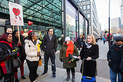 London, UK. 14th February, 2019. Rebecca Long-Bailey (r), Shadow Secretary of State for Business, Energy and Industrial Strategy, shows solidarity on a Valentine's Day-themed picket line outside the Department of Business, Energy and Industrial Strategy (BEIS) with outsourced support staff from the Public & Commercial Services (PCS) union taking strike action to demand the London Living Wage and an end to outsourcing.