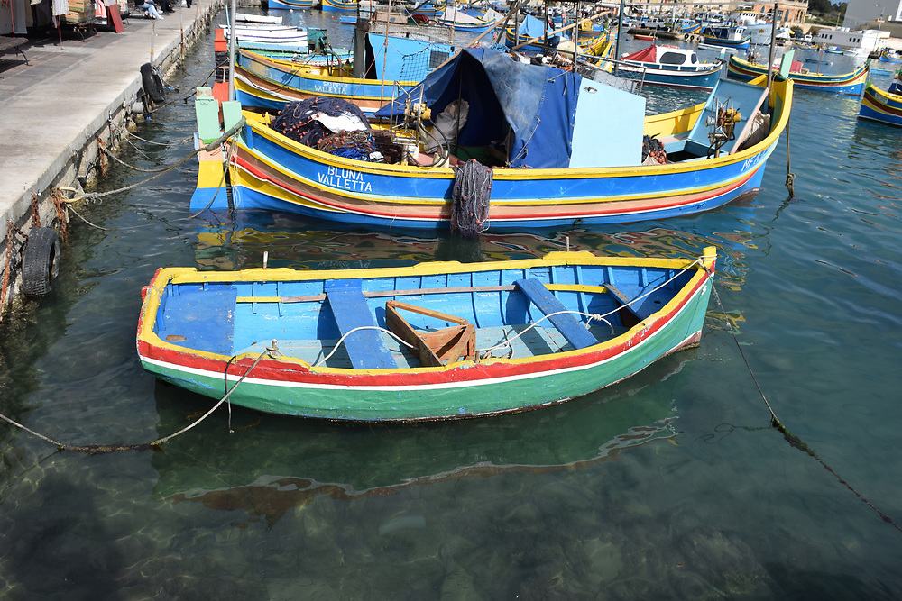 Small Fishing Dinghy and boats in Marsaxlokk