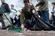 April 2, 2011 - The remains of disembowed pillows and other debris is swept up in Cambridge Common on Saturday after a giant pillow fight. The event was part of International Pillow Fight Day and had an estimated 1000 participants. Photo by Lathan Goumas.