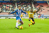 Yanic Wildschut of Wigan Athletic igets a shot in ahead of Abu Ogogo of Shrewsbury Town during the Sky Bet League 1 match at the DW Stadium, Wigan<br /> Picture by Matt Wilkinson/Focus Images Ltd 07814 960751<br /> 21/11/2015