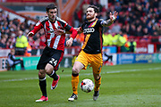 Bradford City midfielder Romain Vincelot (6) is held by Sheffield United defender, on loan from Burnley, Danny Lafferty (24)  during the EFL Sky Bet League 1 match between Sheffield Utd and Bradford City at Bramall Lane, Sheffield, England on 17 April 2017. Photo by Simon Davies.