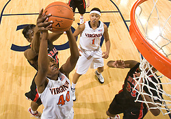 Virginia guard Enonge Stovall (40) grabs an offensive rebound off a missed free throw with 22 seconds left and is fouled by Georgia forward Porsha Phillips (21). Stovall converted both free throws to seal UVA's victory over UGA.  The #15 ranked Virginia Cavaliers defeated the Georgia Lady Bulldogs 62-60 in NCAA Women's Basketball at the John Paul Jones Arena on the Grounds of the University of Virginia in Charlottesville, VA on January 2, 2009.