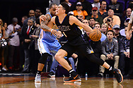 Jan 28, 2017; Phoenix, AZ, USA; Phoenix Suns guard Devin Booker (1) handles the ball against Denver Nuggets guard Jameer Nelson (1) in the first half of the NBA game at Talking Stick Resort Arena. Mandatory Credit: Jennifer Stewart-USA TODAY Sports