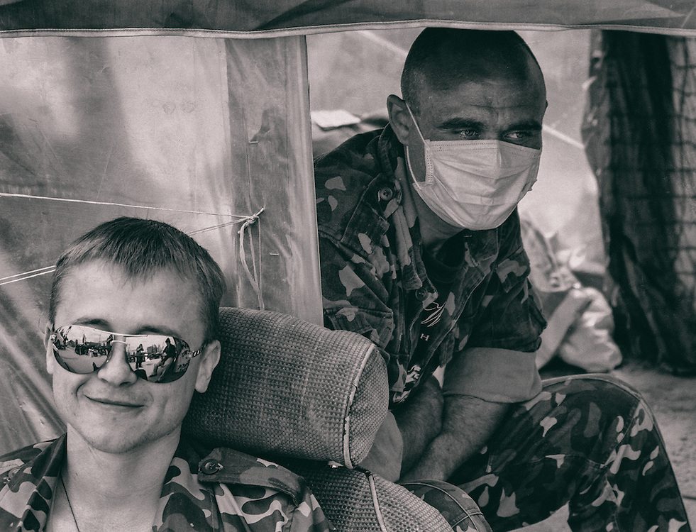14 May 2014 - Ukraine - Slaviansk - Two soldiers having a rest at the check point at the entrance of the city of Slaviansk.