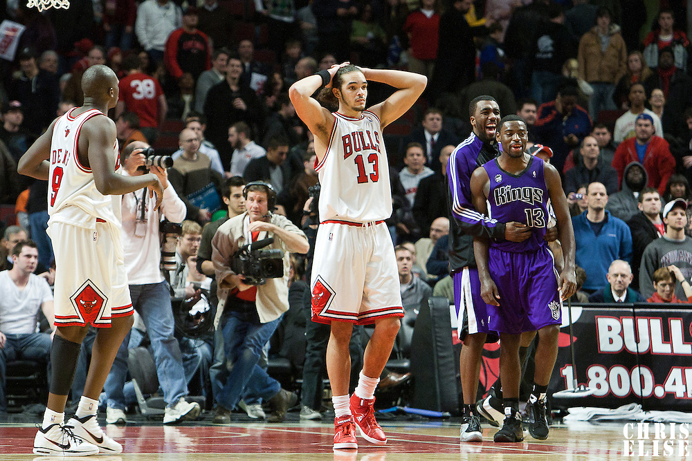 21 December 2009: Chicago Bulls center Joakim Noah looks dejected while Sacramento Kings guard Tyreke Evans celebrates during the Sacramento Kings 102-98 victory over the Chicago Bulls at the United Center, in Chicago, Illinois, USA.