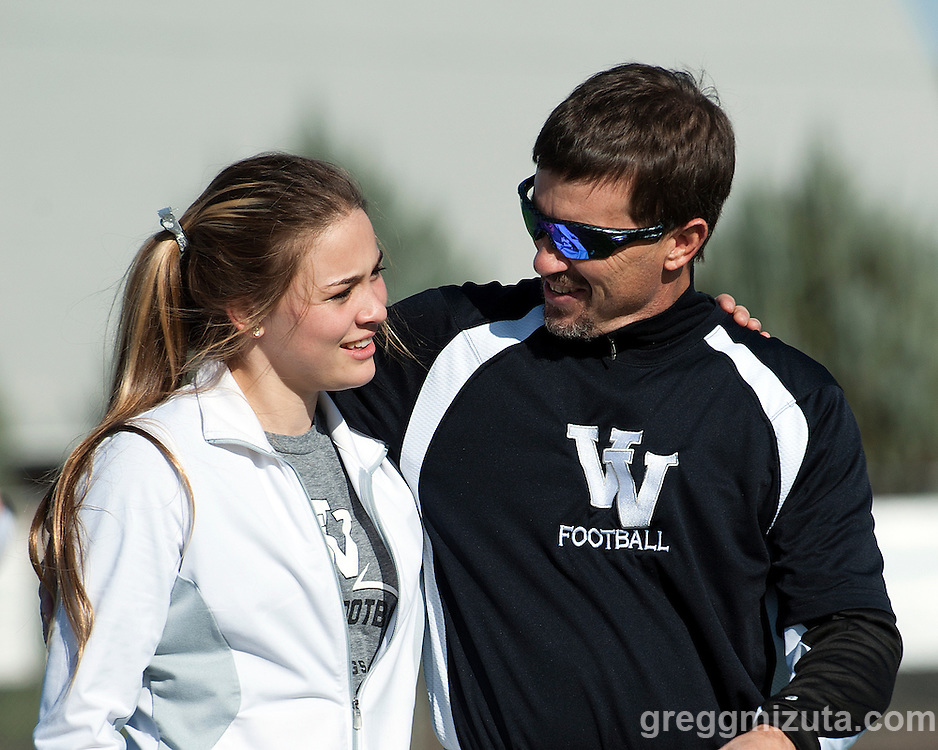 Daughter and Father, Gracie and Jeff Jacobs, before the start of the Vale - Coquille 3A round one football playoff game at Frank Hawley Stadium, Vale, Oregon, November 8, 2014