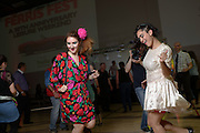 Eloise Edwards, left, and Joan Alba on the dance floor at the Shermer High School 1986 Spring Dance that's part of the Ferris Fest at the Athletico Center on, Friday, March 20, 2016, in Northbrook. (Photo by Rob Hart)