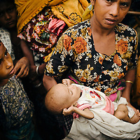 Sittwe IDP camps. May 2013.<br /> <br /> Baby 7 months old, Umar.<br /> Mother Zorah Atu, 30.<br /> <br /> 5 months in Pauktauw camp.