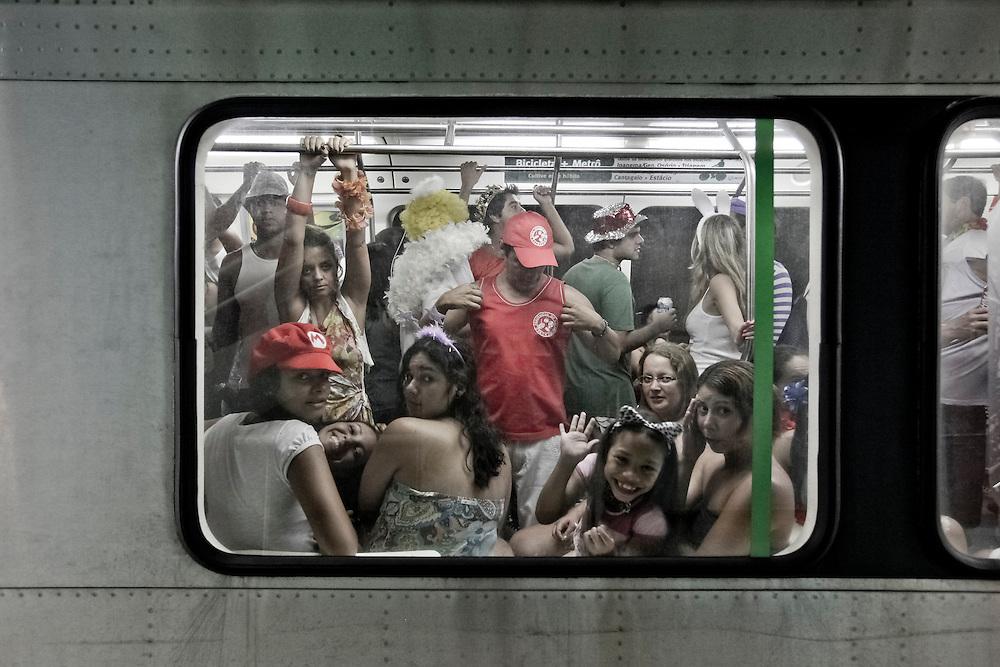 RIO DE JANEIRO, BRAZIL – MARCH 6, 2011: Revelers on the metro on the way to a street carnival in Rio de Janeiro.