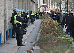 © under license to London News Pictures. 14/12/10. Police surround New Scotland Yard ahead of an anti-kettling demonstration. Protesters hold a demonstration outside New Scotland yard, in London, over the Metropolitan Police's 'kettling' tactics at recent demonstrations . Credit should read Matt Cetti-Roberts/London News Pictures