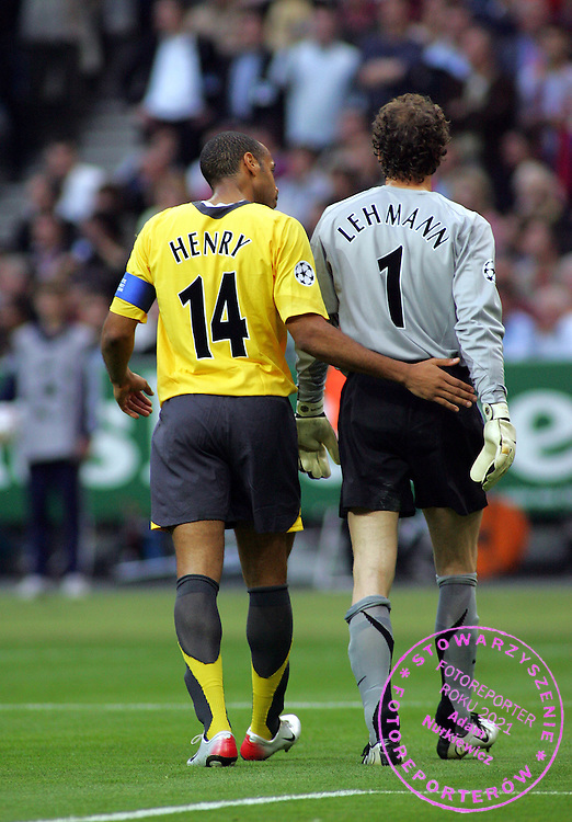 Thierry Henry tries to Console Jens Lehmann after being shown the Red Card for his foul on Barcelona's Samuel Eto'o.Arsenal 2005/06.Barcelona V Arsenal Champions League Final 17/05/06.at the Stade de France.Photo Robin Parker Fotosports International