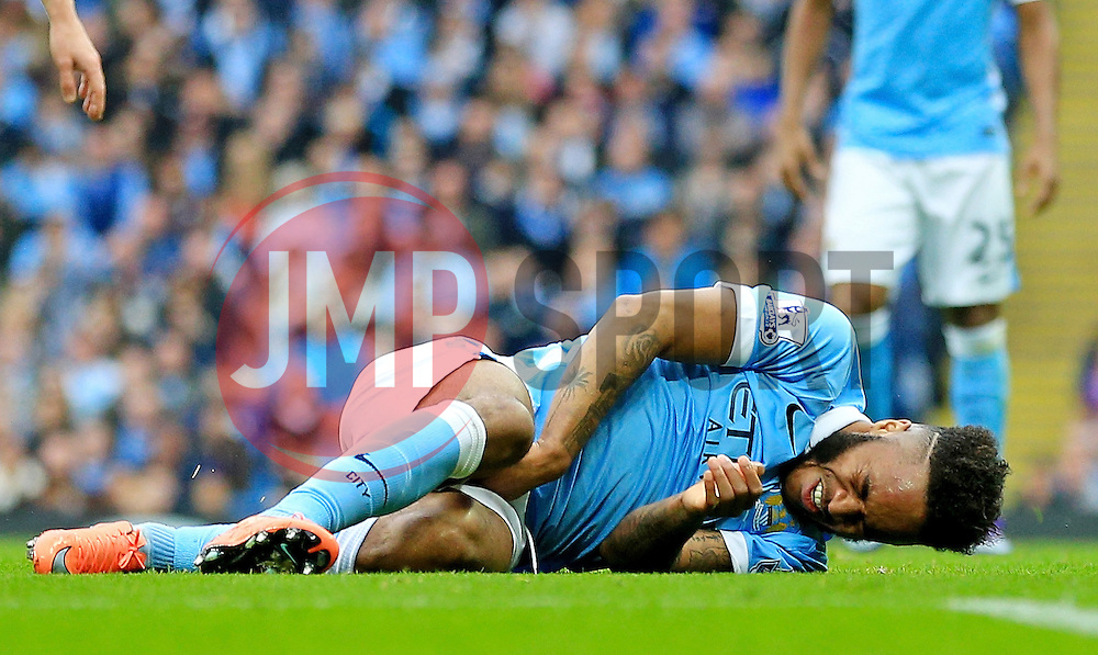 Raheem Sterling of Manchester City picks up an injury - Mandatory byline: Matt McNulty/JMP - 20/03/2016 - FOOTBALL - Etihad Stadium - Manchester, England - Manchester City v Manchester United - Barclays Premier League