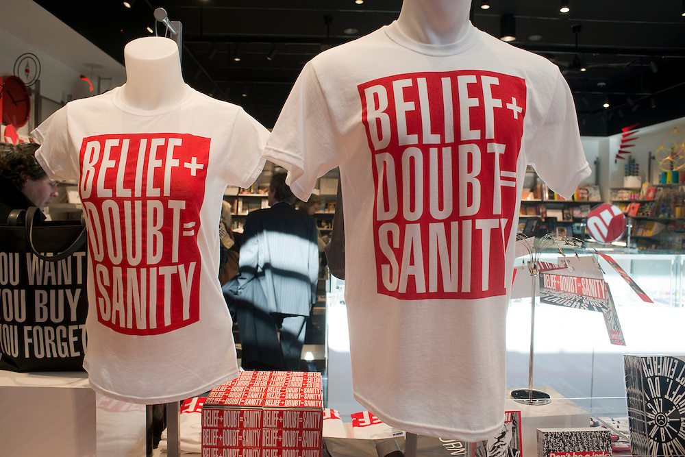 "Barbara Kruger t-shirts depicting the words ""Belief + Doubt = Sanity,"" are sold at the Hirshhorn Museum gift shop in Washington, DC."