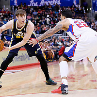 01 February 2014: Utah Jazz shooting guard Gordon Hayward (20) looks to pass over Los Angeles Clippers small forward Matt Barnes (22) during the Los Angeles Clippers 102-87 victory over the Utah Jazz at the Staples Center, Los Angeles, California, USA.