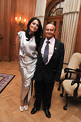 RENU MEHTA and her father VIJAY MEHTA at the 4th Fortune Forum Summit held at The Dorchester Hotel, Park Lane, London on 4th December 2012.