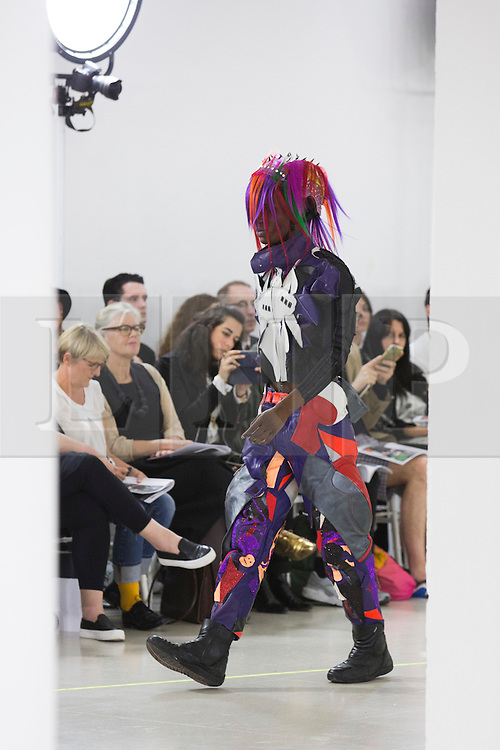 © Licensed to London News Pictures. 03/06/2015. London, UK. Collection by Kathryn McGee. A model walks the runway at the Royal College of Art (RCA) MA Fashion graduate fashion show.  Photo credit : Bettina Strenske/LNP