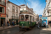 Green tram in Largo do Calhariz, Lisbon, Portugal