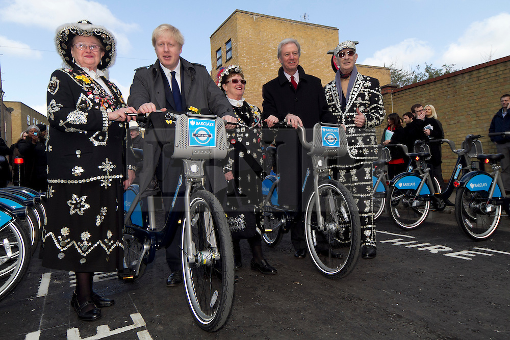 © Licensed to London News Pictures. 08/03/2012. London, UK. Mayor of London Boris Johnson (left) with Marcus Aigus (Right, Chairman of Barclays) pictured with a Pearly King and two Pearly Queens  on Hewison Road in Bow today (08/03) to publicise the eastern extension of the Barclays Bike cycle hire scheme which launches today. Photo credit : James Gourley/LNP