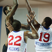 Erie BayHawks Forward CJ Leslie (11) shoots a jump shot as Delaware 87ers Forward Rodney Williams (22) and Delaware 87ers Forward Thanasis Antetokounmpo (19) defend in the second half of a NBA D-league regular season basketball game between the Delaware 87ers (76ers) and the Erie BayHawks (Knicks) Monday, Jan 13, 2014 at The Bob Carpenter Sports Convocation Center, Newark, DE
