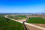 Nederland, Friesland, Leeuwarden, 01-05-2013; aanleg N31 de Haak om Leeuwarden. Kruising met water van de Swette )Zwette). Leeuwarden aan de horizon..De nieuwe rijksweg vormt de verbinding tussen de huidige A31 bij Marsum en de N31 bij Hemriksein (Wâldwei)..Construction of new motorway N31, near Leeuwarden (background) , crossing channel Zwette.  .luchtfoto (toeslag op standard tarieven).aerial photo (additional fee required).copyright foto/photo Siebe Swart