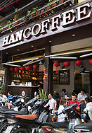 Young Vietnamese in a coffee shop surrounded by their motorcycles in the Old Quarter, Hanoi, Vietnam, Southeast Asia