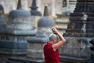 Early morning prostrations in Mahabodhi Temple, where Buddha attained enlightment - Bodhgaya, India, 2016