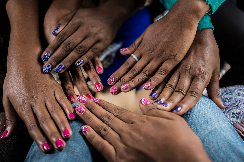 The surfer girls proudly showing their nails done