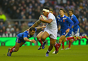 Twickenham, GREAT BRITAIN, Manu TUILAGI,  breaking through the tackle fro Margon PARRA, during the 2013, 6 Nations Rugby match, England vs France. Played at the RFU Stadium Twickenham, Surrey on, Saturday  23/02/2013  [Photo, Peter Spurrier/Intersport-images]