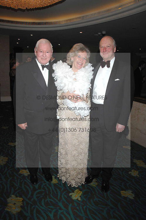 Left to right,  SIR DONALD GOSLING and MR &amp; MRS JOHN ANDREWES at the Boodles Big Bash in support of The Outward Bound Trust held at The Hilton, Park Lane, London on 22nd February 2007.<br />