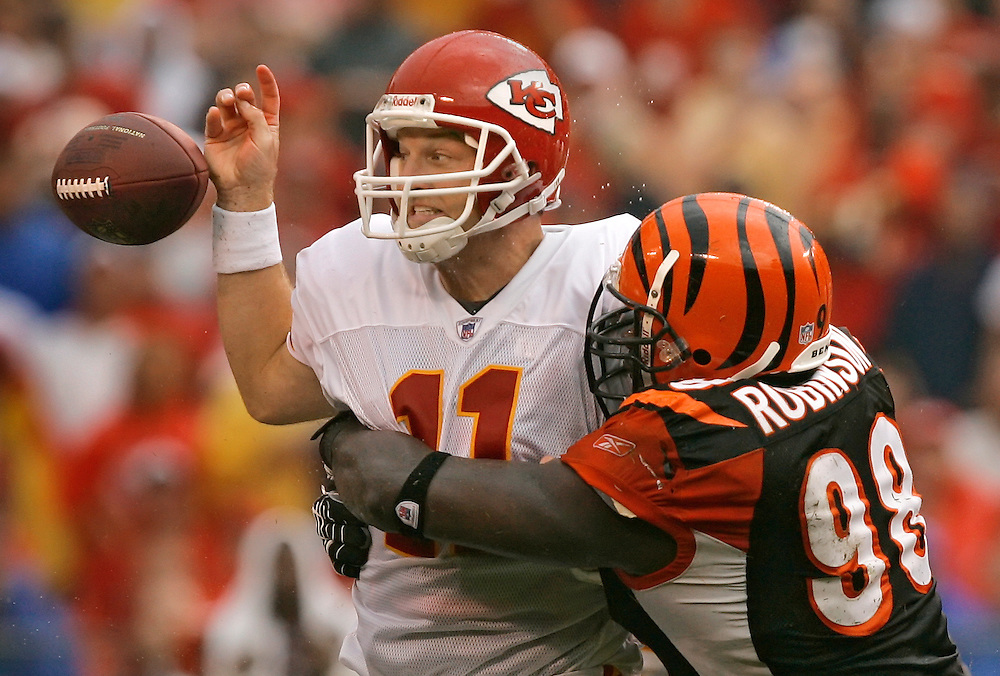 Kansas City Chiefs quarterback Damon Huard has the ball jarred from his hand by Cincinnati Bengals defensive end Bryan Robinson, right, in the third quarter on September 10, 2006 at Arrowhead Stadium in the season's regular season opener. Huard subsituted for an injured Trent Green while the Chiefs lost 23-10.