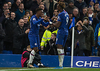 Football - 2019 / 2020 Premier League - Chelsea vs. Burnley<br /> <br /> Callum Hudson-Odoi (Chelsea FC) and Tammy Abraham (Chelsea FC) after Chelsea score their 3rd goal at Stamford Bridge <br /> <br /> COLORSPORT/DANIEL BEARHAM