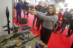 October 9, 2018 - Kiev, Kiev, Ukraine - Ukrainian girl seen testing guns during the Arms and Security 2018 international exhibition in Kiev, Ukraine..The exhibition involves 500 companies from 17 countries: United States, Turkey, China, the United Arab Emirates, Germany, Poland, the Czech Republic, Slovakia, Croatia, Austria, Luxembourg, Denmark, Latvia, Kazakhstan, Ukraine, who exhibit like 60 units of machinery and 11 aircraft units. The runs for 4 days. (Credit Image: © Pavlo Gonchar/SOPA Images via ZUMA Wire)
