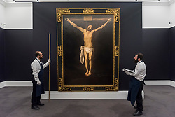 "© Licensed to London News Pictures. 29/11/2019. LONDON, UK. Technicians inspect ""Christ on the Cross"", circa 1635-40, by Francisco de Zurbaran (Est. GBP2.5-5.0m) at the preview of Old Masters sales at Sotheby's, New Bond Street.  Works will be offered for sale on 4 and 5 December.  Photo credit: Stephen Chung/LNP"