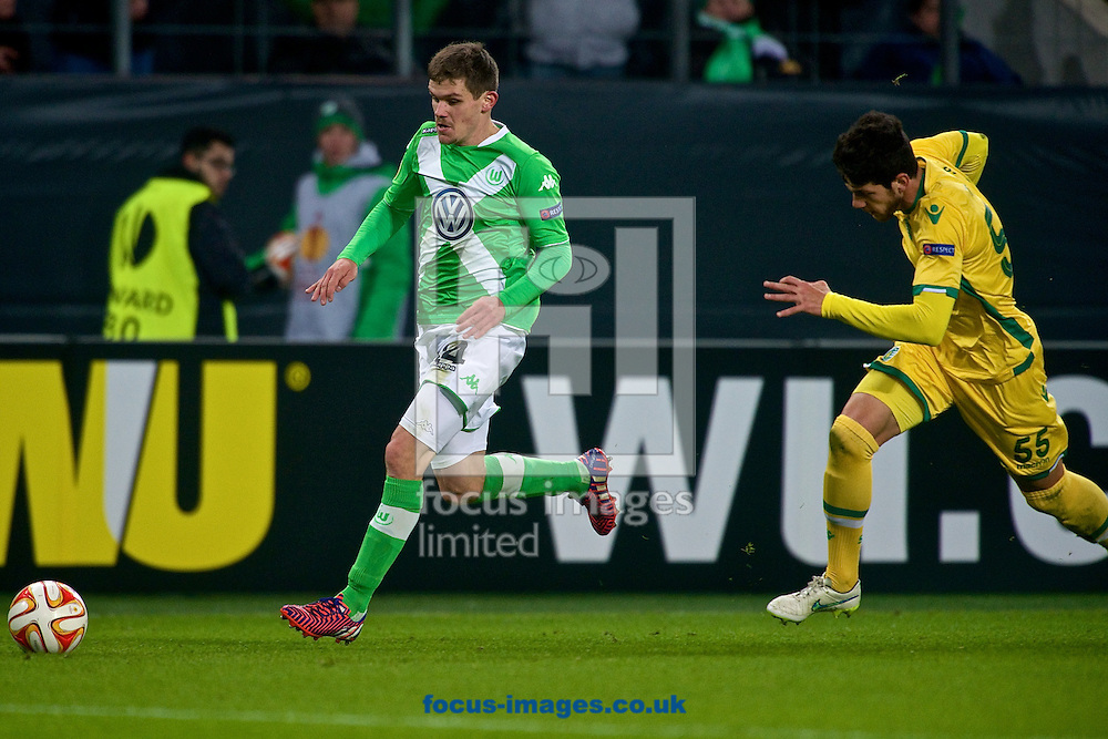 Sebastian Jung of VfL Wolfsburg (left) and  of Sporting Clube de Portugal during the UEFA Europa League match at Volkswagen Arena, Wolfsburg<br /> Picture by Ian Wadkins/Focus Images Ltd +44 7877 568959<br /> 19/02/2015