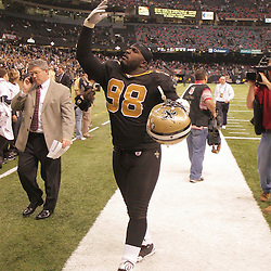 2008 December, 07: New Orleans Saints defensive tackle Sedrick Ellis (98) waves to the crowd as he walks off the field following a 29-25 victory by the New Orleans Saints over NFC South divisional rivals the Atlanta Falcons at the Louisiana Superdome in New Orleans, LA.