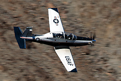United States Air Force Beechcraft T-6 Texan II (03-679) from the 80th Flying Training Wing, Sheppard Air Force Base, Texas, flies low level through the Jedi Transition, Star Wars Canyon, Death Valley National Park, California, United States of America