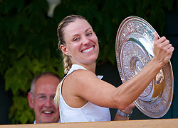 LONDON, ENGLAND - Saturday, July 14, 2018: Angelique Kerber (GER) with the Venus Rosewater Dish trophy as she celebrates winning the Ladies' Singles Final match 6-3, 6-3 on day twelve of the Wimbledon Lawn Tennis Championships at the All England Lawn Tennis and Croquet Club. (Pic by Kirsten Holst/Propaganda)