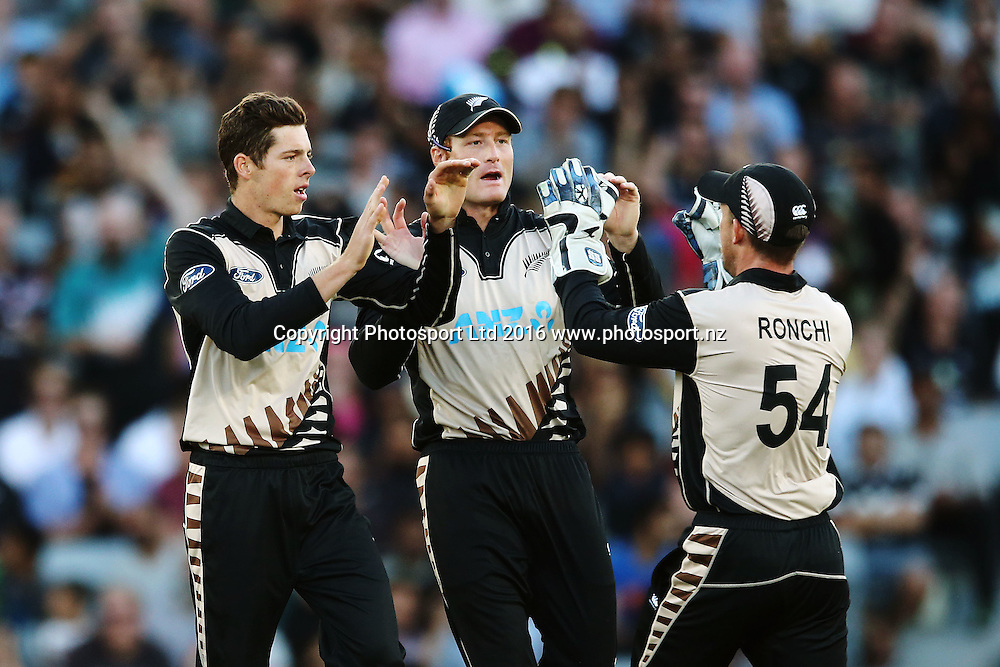Mitchell Santner of New Zealand celebrates with Martin Guptill and Luke Ronchi for his wicket of Sohaib Maqsood of Pakistan. ANZ International Series, Twenty-20 Match between New Zealand Back Caps and Pakistan at Eden Park in Auckland, New Zealand. 15 January 2016. Photo: Anthony Au-Yeung / www.photosport.nz