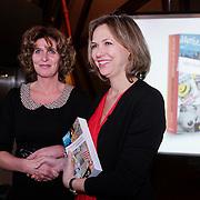 NLD/Amsterdam/20121129- Presentatie Jubileumboek 125 jaar historie Carre, Madeleine van der Zwaan krijgt het eerste boek overhandigt van schrijfster Mariette Wolf