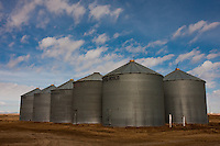 Grain Bins in front of a cloudy blue sky...©2009, Sean Phillips.http://www.Sean-Phillips.com