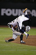 Los Angeles Rams running back Todd Gurley II (30) gets upended by Oakland Raiders defensive back Marcus Gilchrist (31) as he runs for a fourth quarter gain of 23 yards and a first down at the Raiders 35 yard line during the 2018 regular season week 1 NFL football game against the Oakland Raiders on Monday, Sept. 10, 2018 in Oakland, Calif. The Rams won the game 33-13. (©Paul Anthony Spinelli)