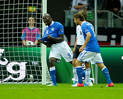 Mario Balotelli celebrates after he scores his team's second goal during the UEFA EURO 2012 semi final match between Germany and Italy at the National Stadium on June 28, 2012 in Warsaw, Poland.