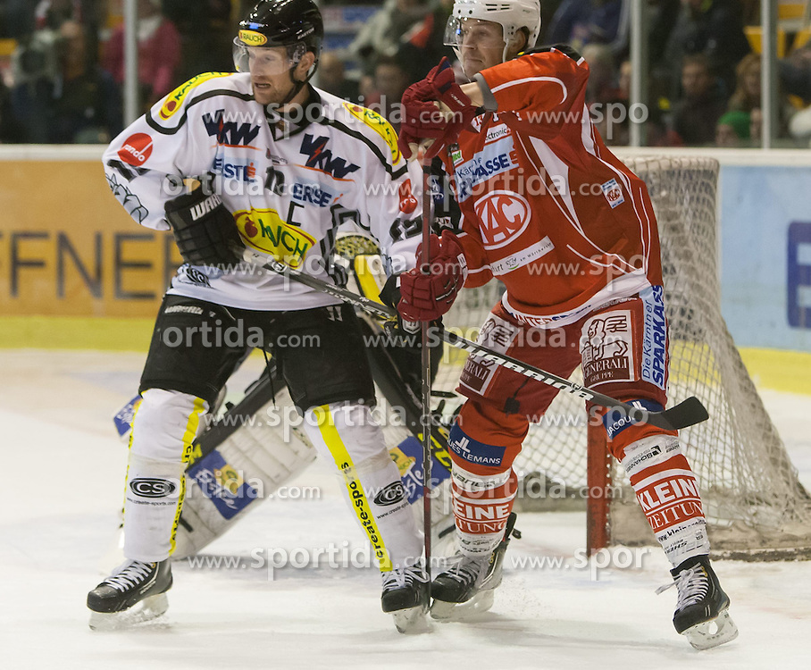 08.12.2013, Stadthalle, Klagenfurt, AUT, EBEL, KAC vs die Dornbirner, 49. Runde, im Bild Fabian Glanznig (Dornbirner Bulldogs, #11), Johannes Reichel (Kac, #14), Adam Dennis (Dornbirner Bulldogs, #44)// during the Erste Bank Icehockey League 49th Round match betweeen EC KAC and die Dornbirner at the City Hall, Klagenfurt, Austria on 2013/12/08. EXPA Pictures © 2013, PhotoCredit: EXPA/ Gert Steinthaler