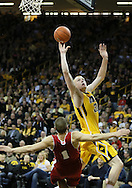 January 19 2013: Iowa Hawkeyes forward Aaron White (30) puts up a shot over Wisconsin Badgers guard Ben Brust (1) during the first half of the NCAA basketball game between the Wisconsin Badgers and the Iowa Hawkeyes at Carver-Hawkeye Arena in Iowa City, Iowa on Sautrday January 19 2013. Iowa defeated Wisconsin 70-66.