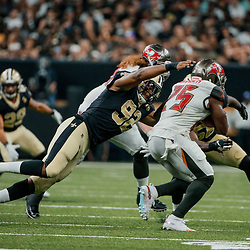 Sep 9, 2018; New Orleans, LA, USA; New Orleans Saints defensive end Marcus Davenport (92) tackles Tampa Bay Buccaneers running back Peyton Barber (25) during the second half of a game at the Mercedes-Benz Superdome. The Buccaneers defeated the Saints 48-40. Mandatory Credit: Derick E. Hingle-USA TODAY Sports