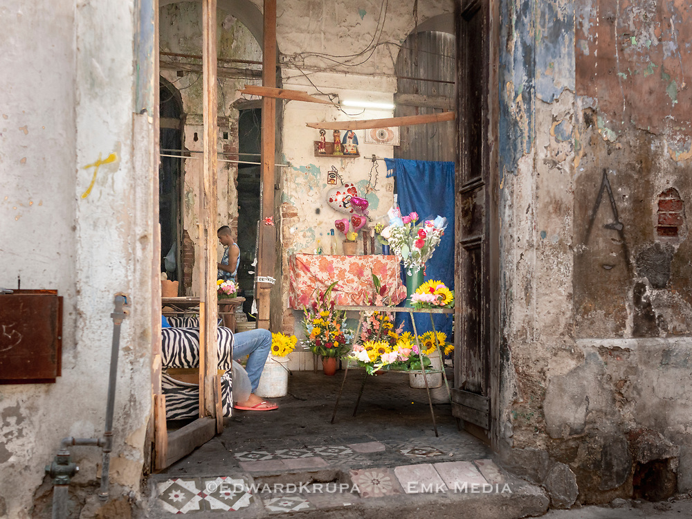 A look inside the open doors of a flower shop located in a old building in Central Havana.