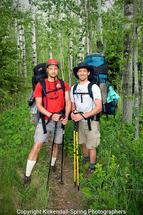 MI00282-00...MICHIGAN - Hikers on the Minong Ridge Trail near McCargoe Cove in Isle Royale National Park.