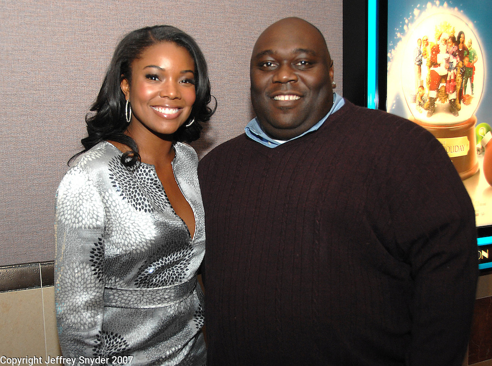 """Gabrielle Union and Faizon Love arriving for a screening of the movie, """"A Perfect Holiday"""" in Washington, DC on December 4, 2007"""